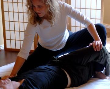 Passive stretches in shiatsu treatment open the spine & help increase flexibility.